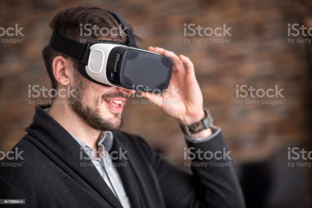 Man wearing VR headset stock photo
