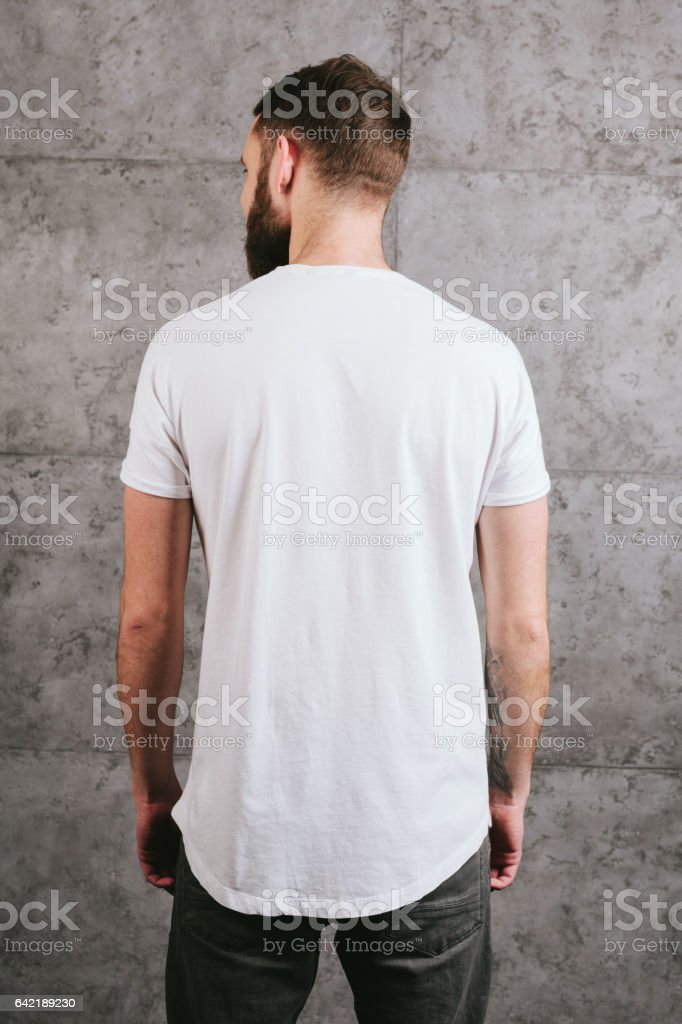 Man wearing white blank t-shirt stock photo