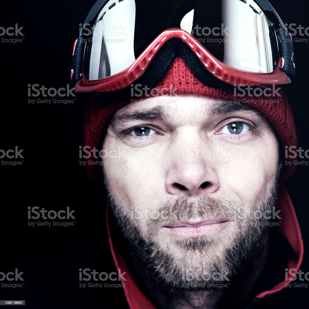 Man Wearing Winter Hat and Ski goggles on Black Background royalty-free stock photo