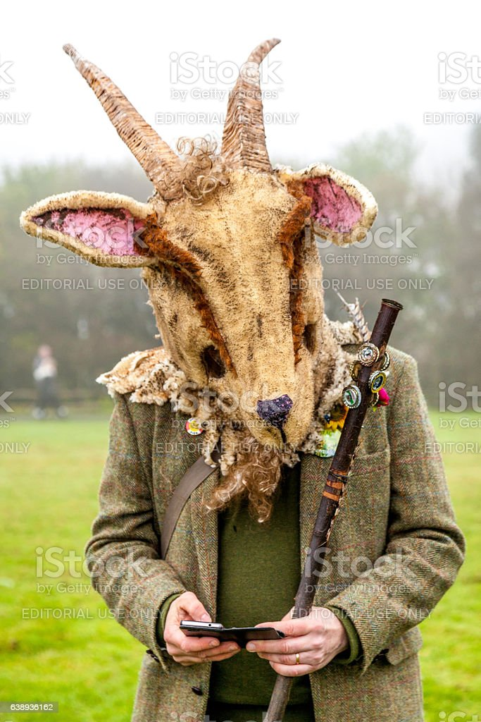 Man wears a goat's head at Hastings' Jack-in-the-Green Festival stock photo