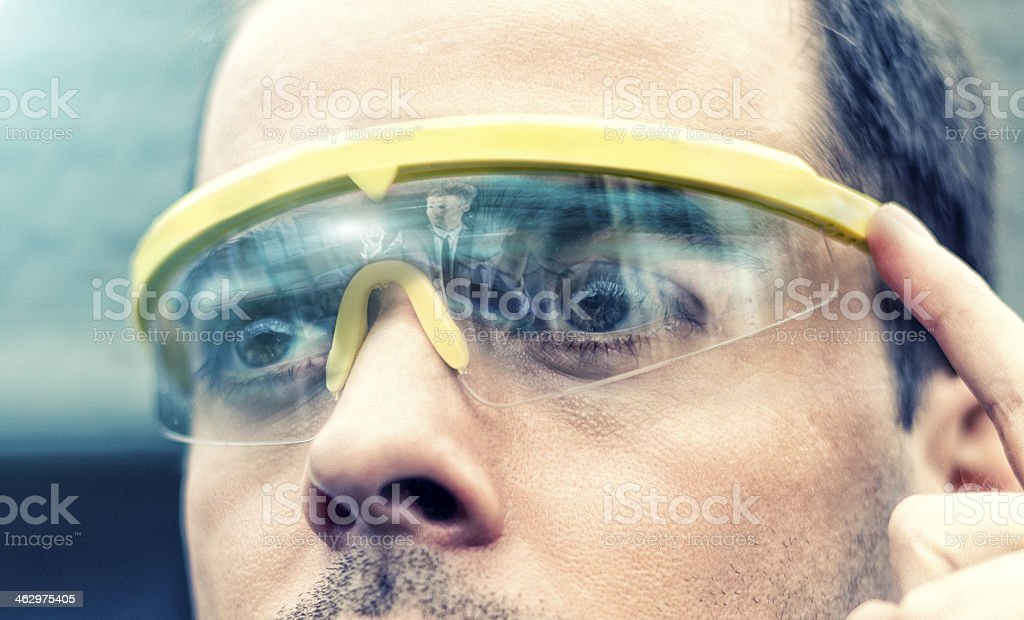 Man wears a pair of futuristic smart glasses royalty-free stock photo