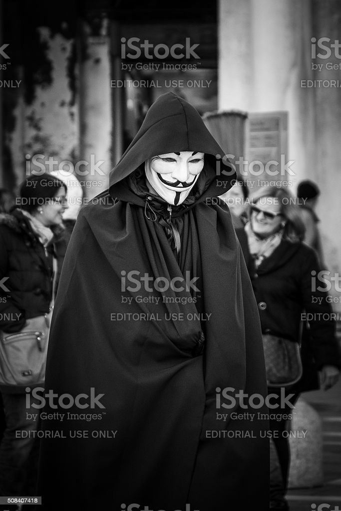 Man wears a V for vendetta, Guy Fawkes mask stock photo