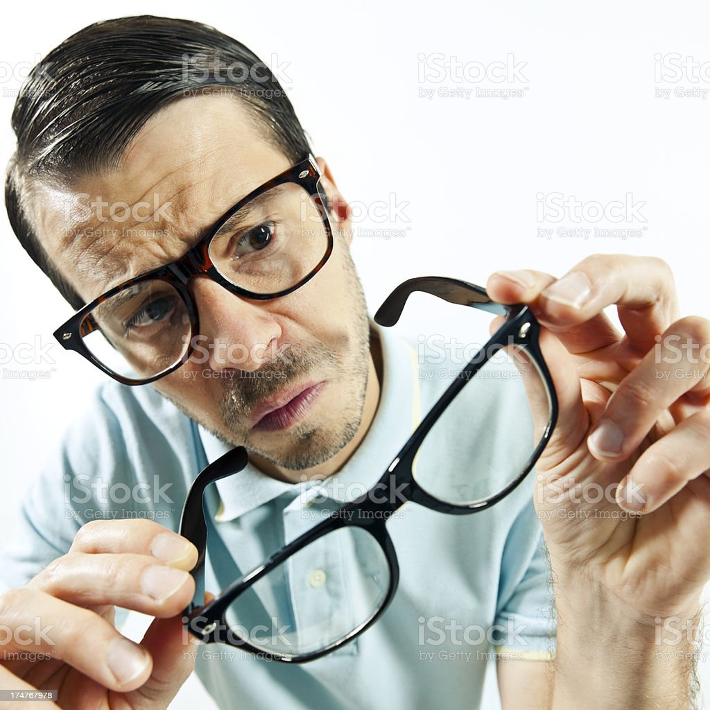 Man wears glasses another pair is holding in hands royalty-free stock photo