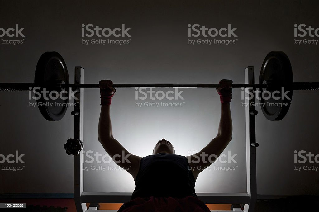 Man weightlifter at the gym stock photo