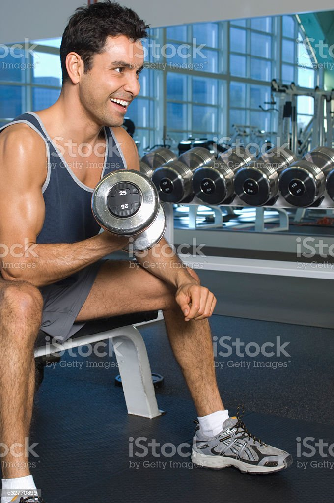 Man Weightlifting With Dumbbell stock photo