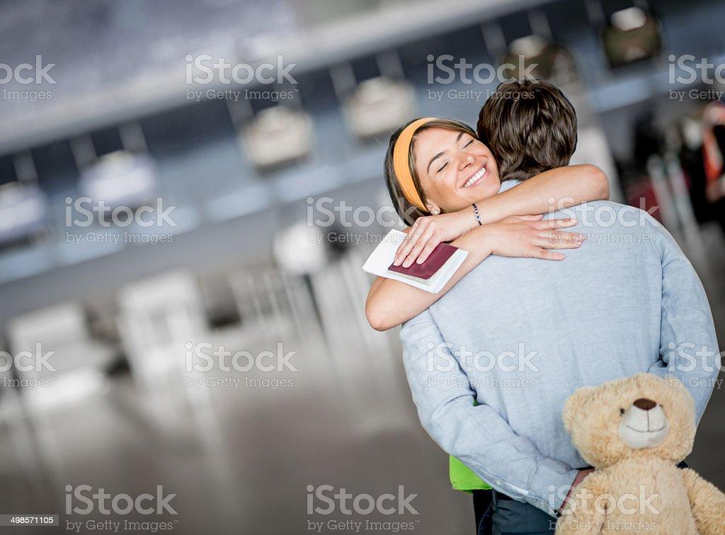 Man welcoming his girlfriend stock photo