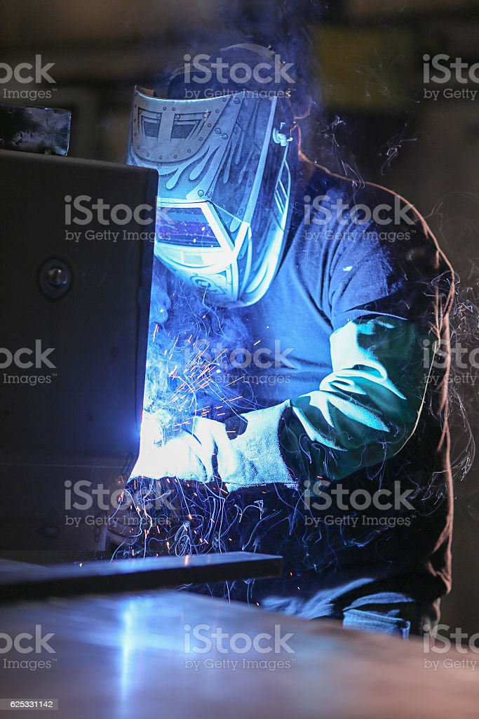 Man Welding in Warehouse stock photo