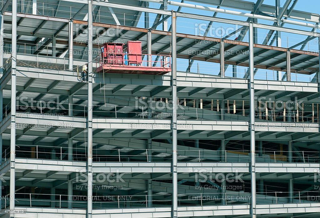 Man welding seams on steel beams of stadium royalty-free stock photo