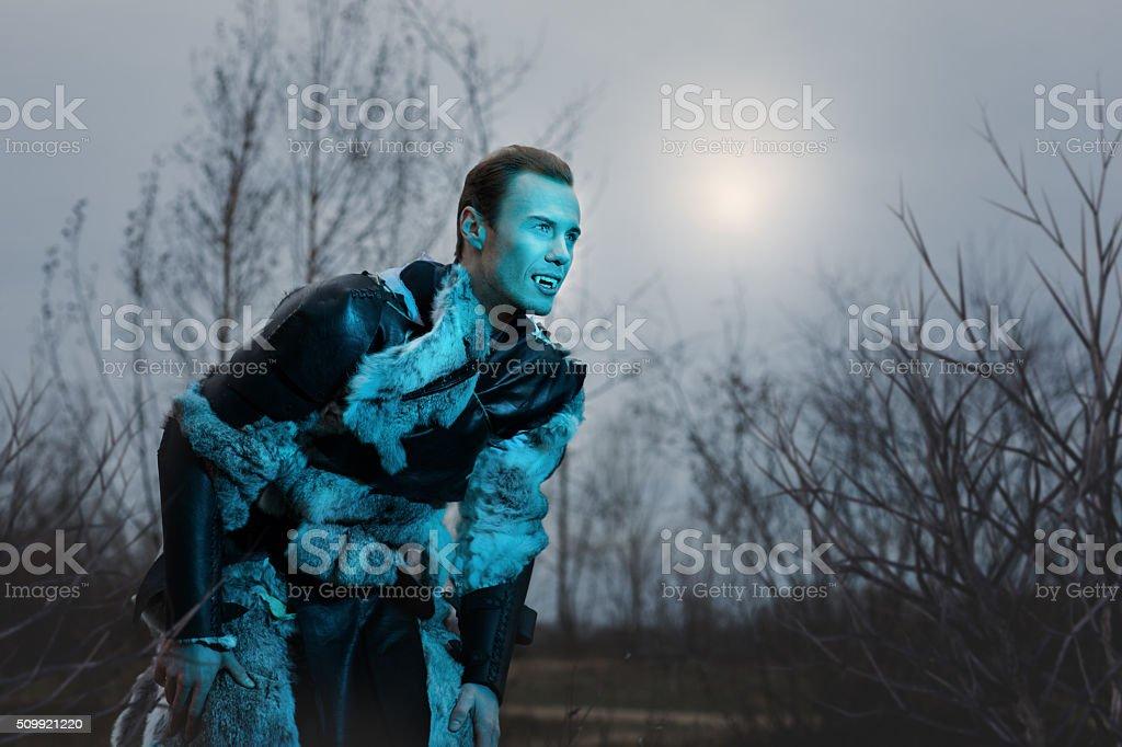 Man Werewolf in animal skins. stock photo