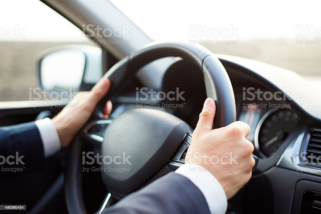 Man while driving stock photo