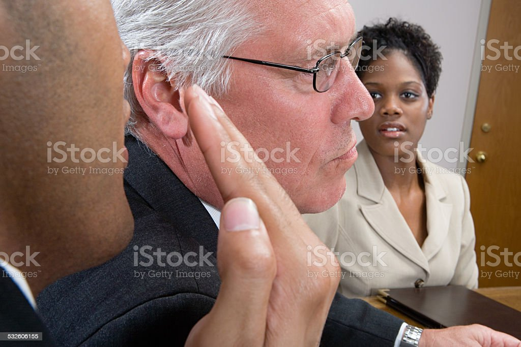 Man whispering in interview stock photo