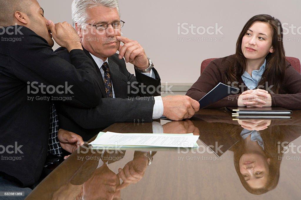 Man whispering in meeting stock photo