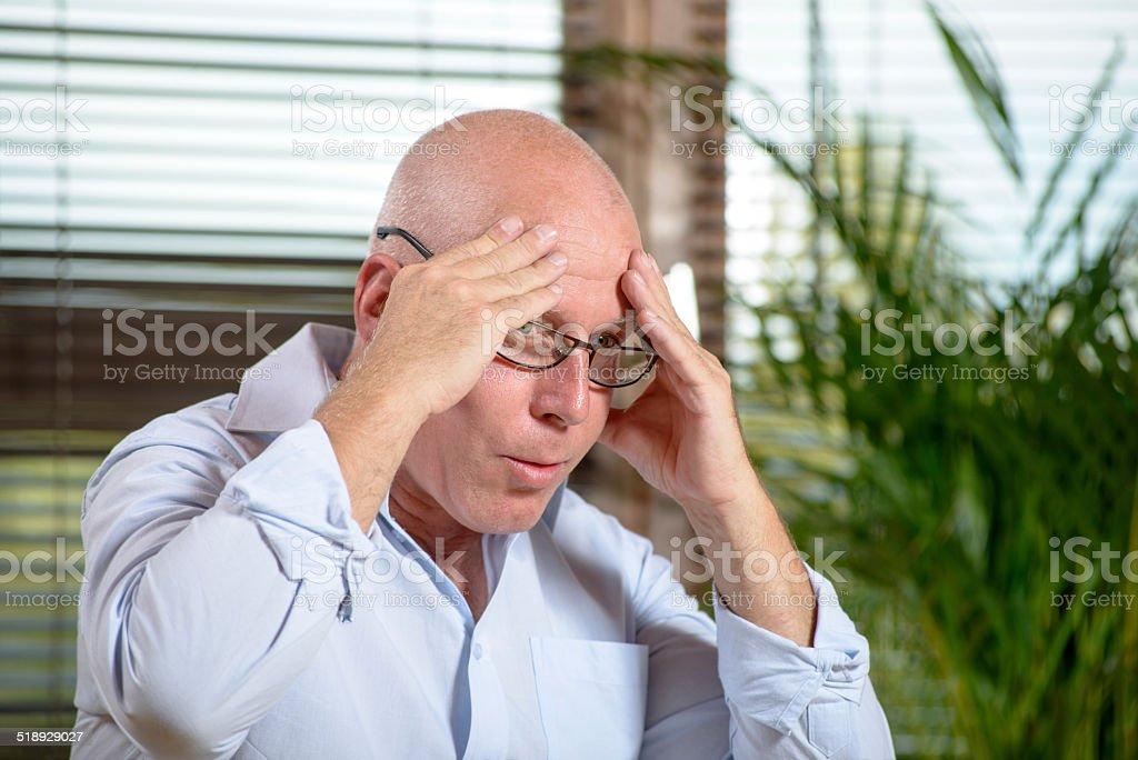 man who has a headache stock photo