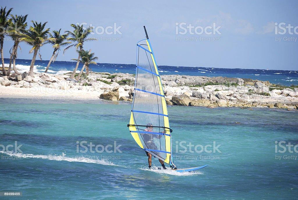 A man windsurfing near the coast on a sunny day royalty-free stock photo