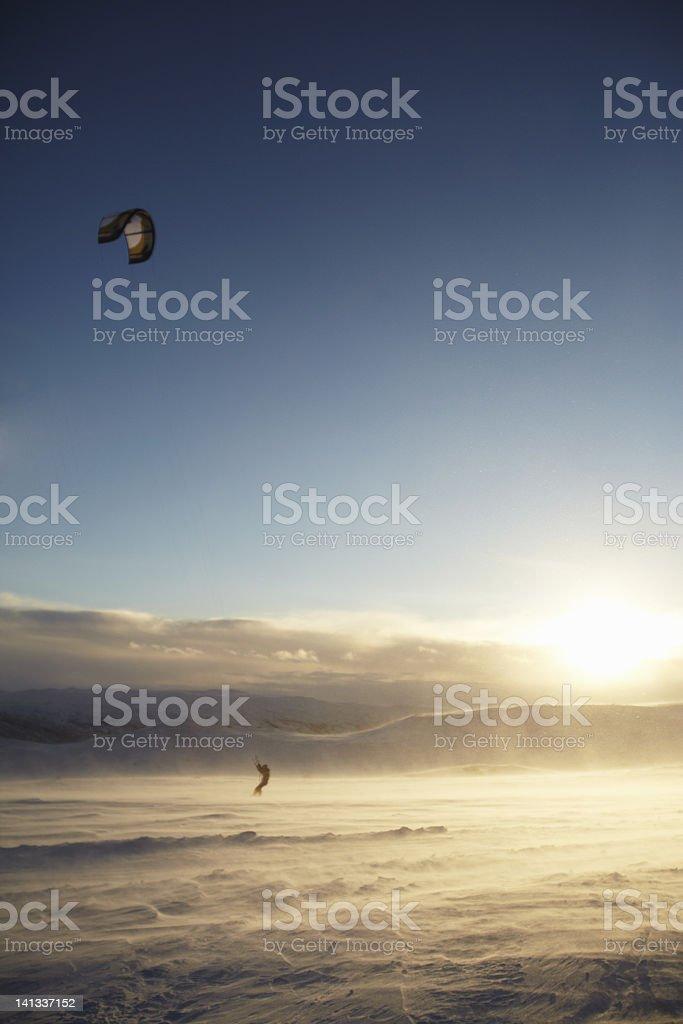 Man windsurfing on snow stock photo