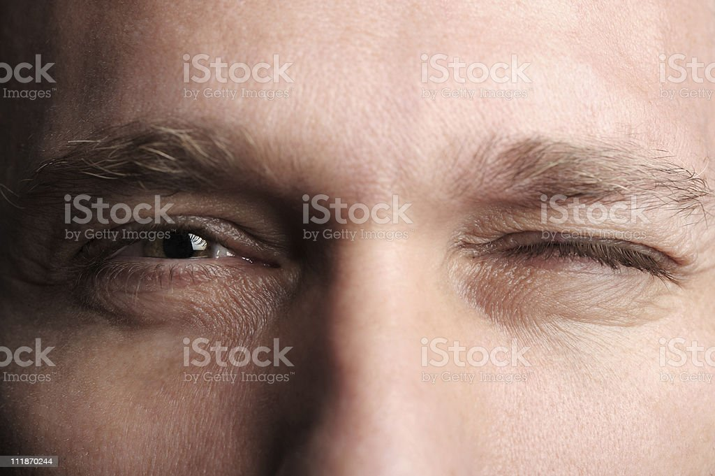 Man Winking Extreme Close up stock photo