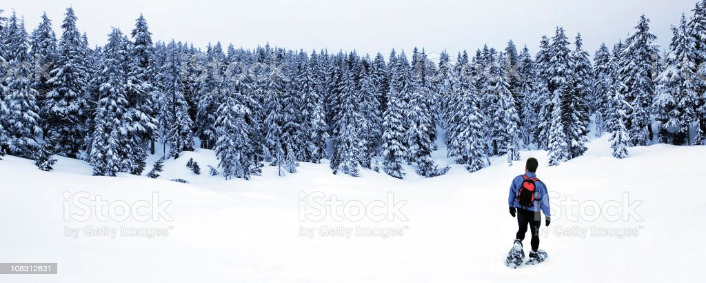 man winter hiking stock photo