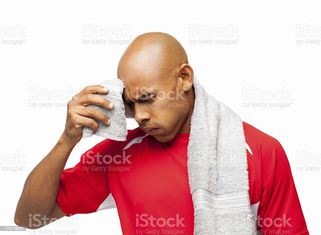 Man Wiping Sweat - Isolated royalty-free stock photo