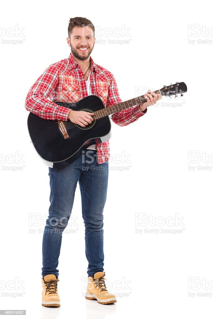 Man with a acoustic guitar stock photo