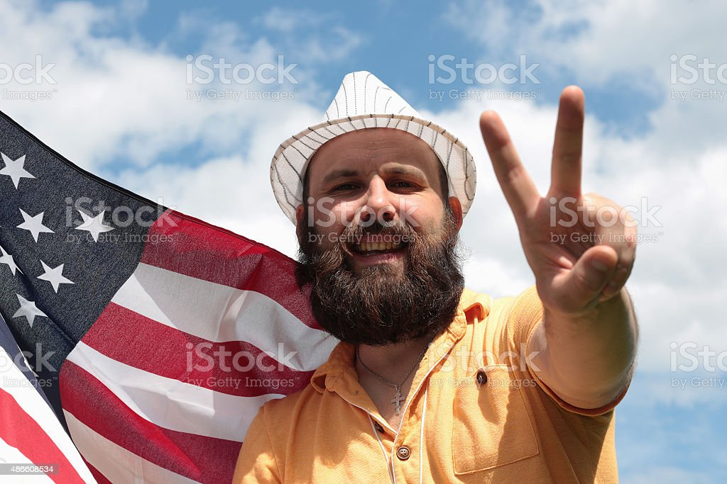 man with a beard with American flag stock photo