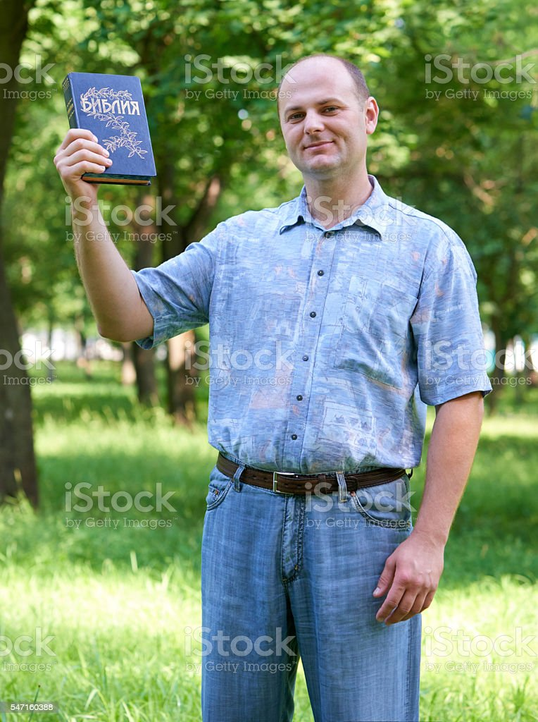 man with a Bible, religion people concept stock photo
