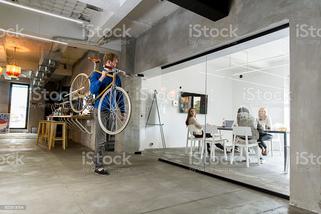 Man with a bicycle stock photo