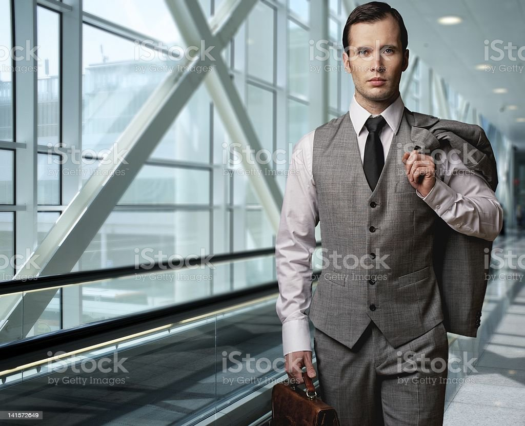 Man with a briefcase in an airport. stock photo