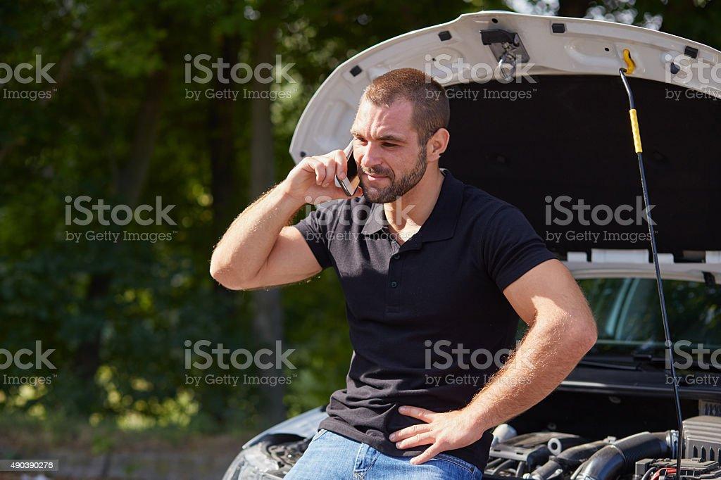 Man with a broken car stock photo
