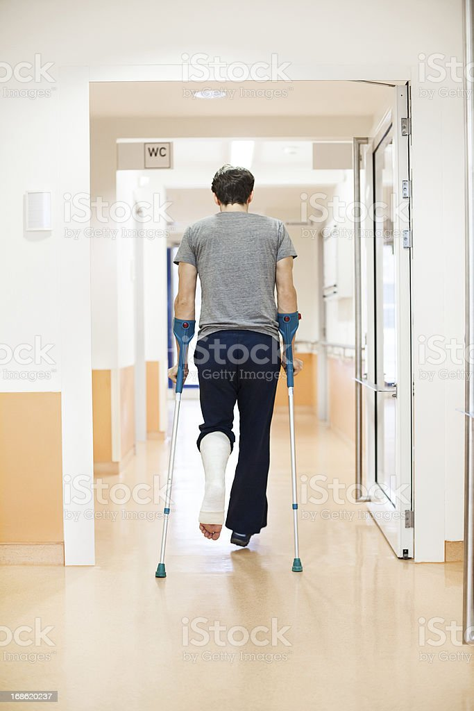 Man with a broken leg at the hospital stock photo