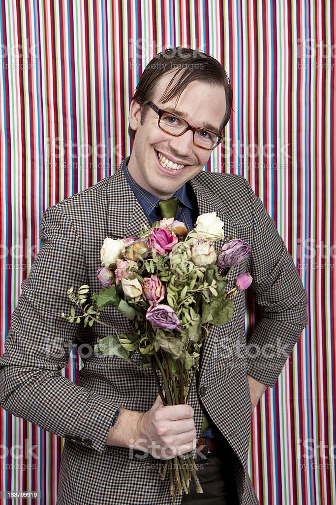 Man with a bunch of old flowers stock photo