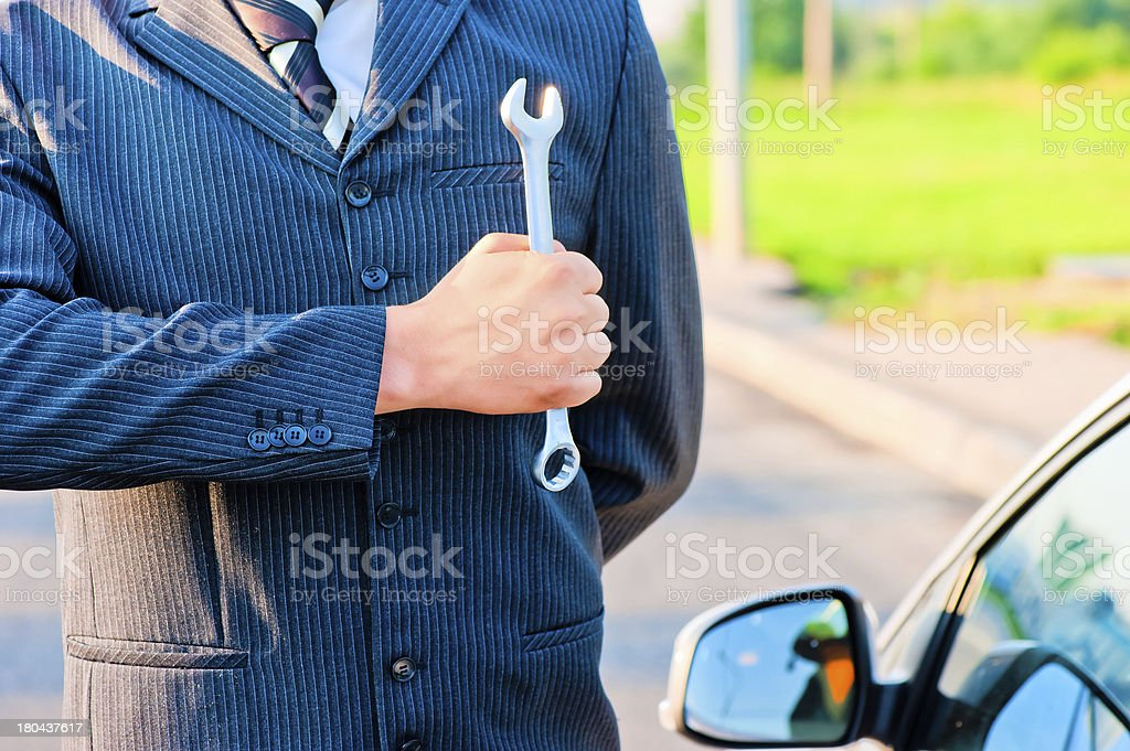 man with a car holding  wrench royalty-free stock photo