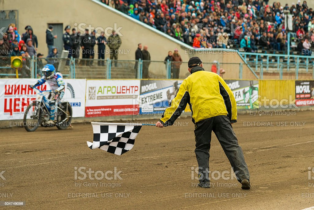 Man with a checkered flag finish shows stock photo