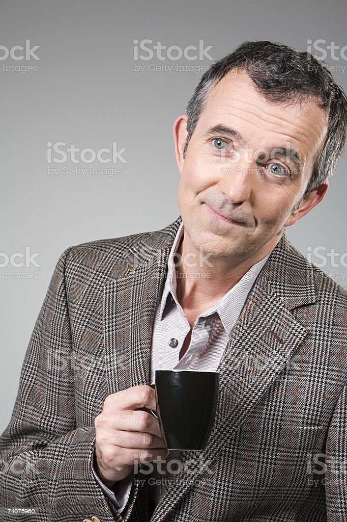 Man with a coffee cup stock photo