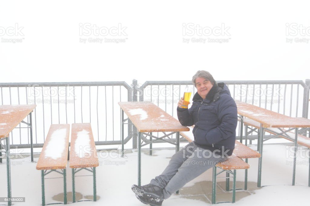 Man with a Cold Beer in Cold Weather stock photo