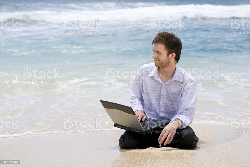 Man with a Computer on the Beach royalty-free stock photo