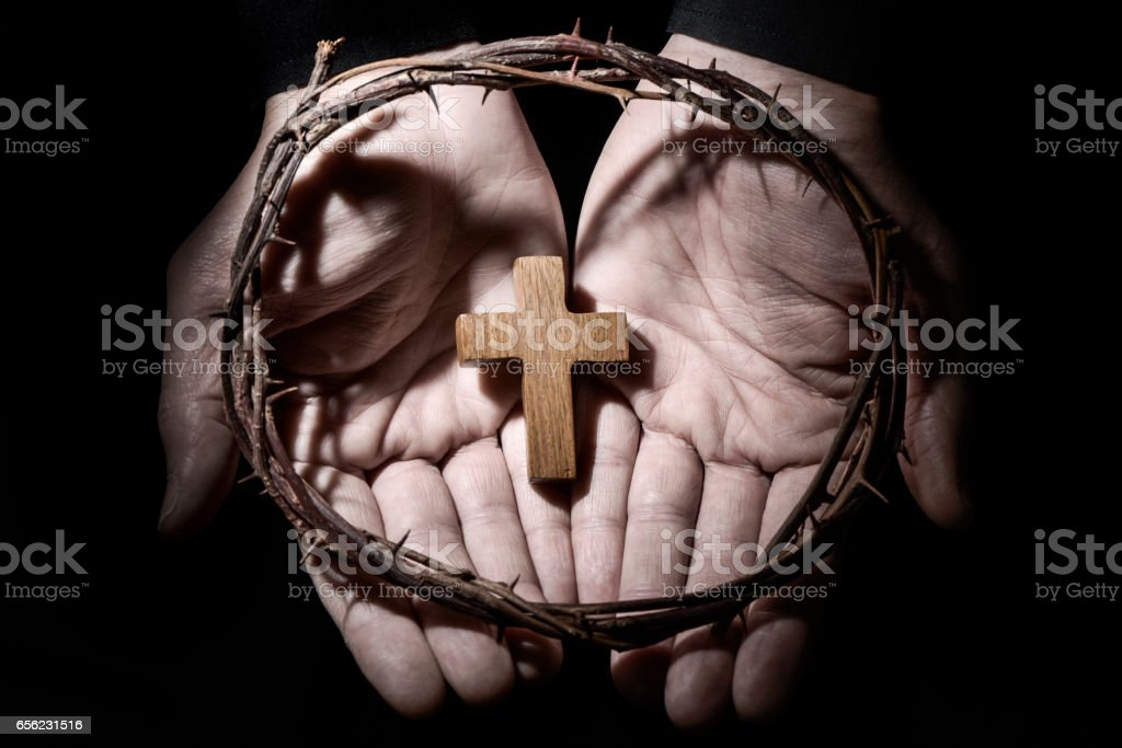 man with a cross and a crown of thorns stock photo