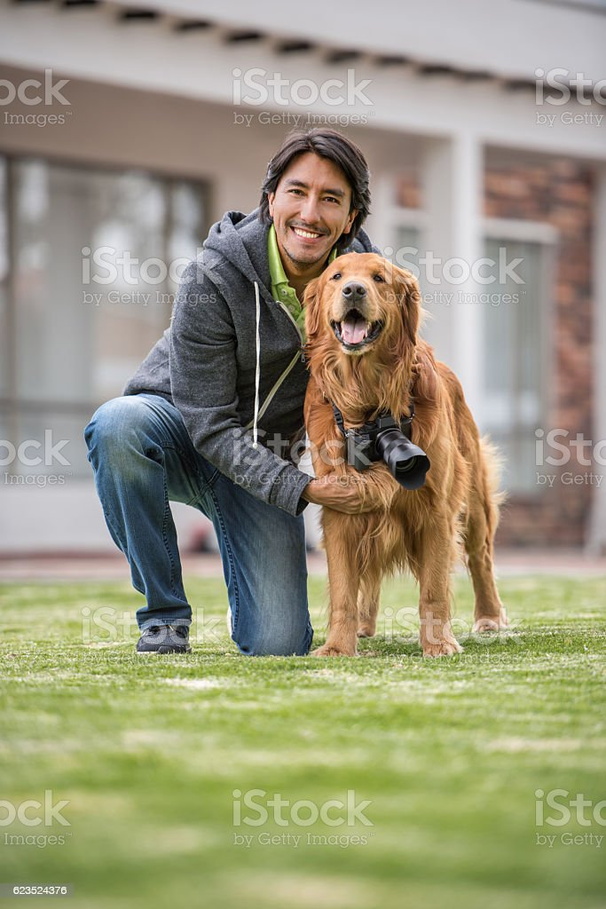 Man with a dog photographer stock photo