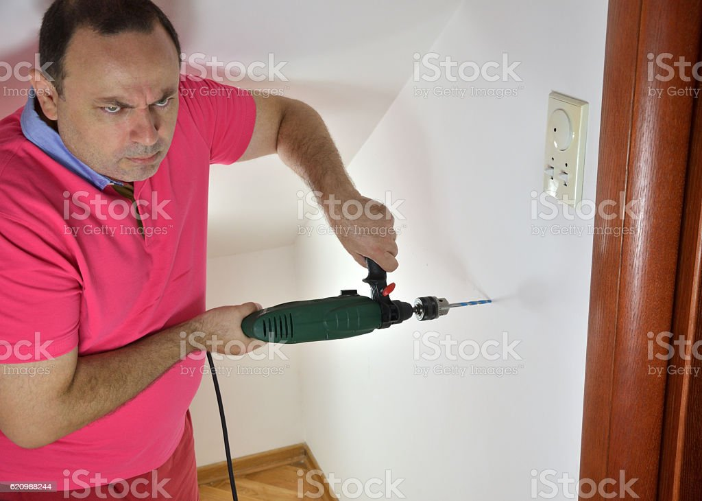 Man with a Drill stock photo