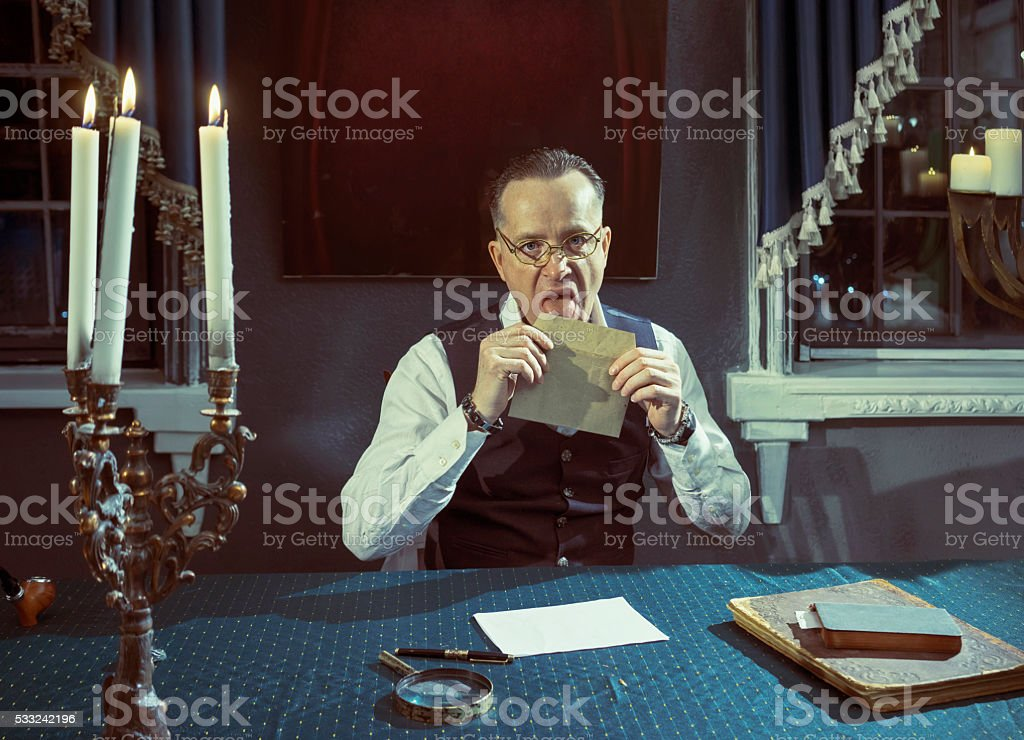 Man with a envelope in hands stock photo