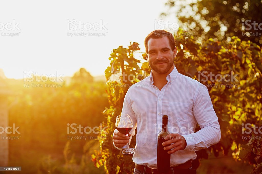 Man with a glass of red wine stock photo