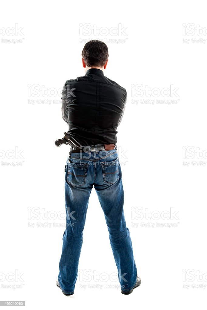 Man with a gun behind his back royalty-free stock photo