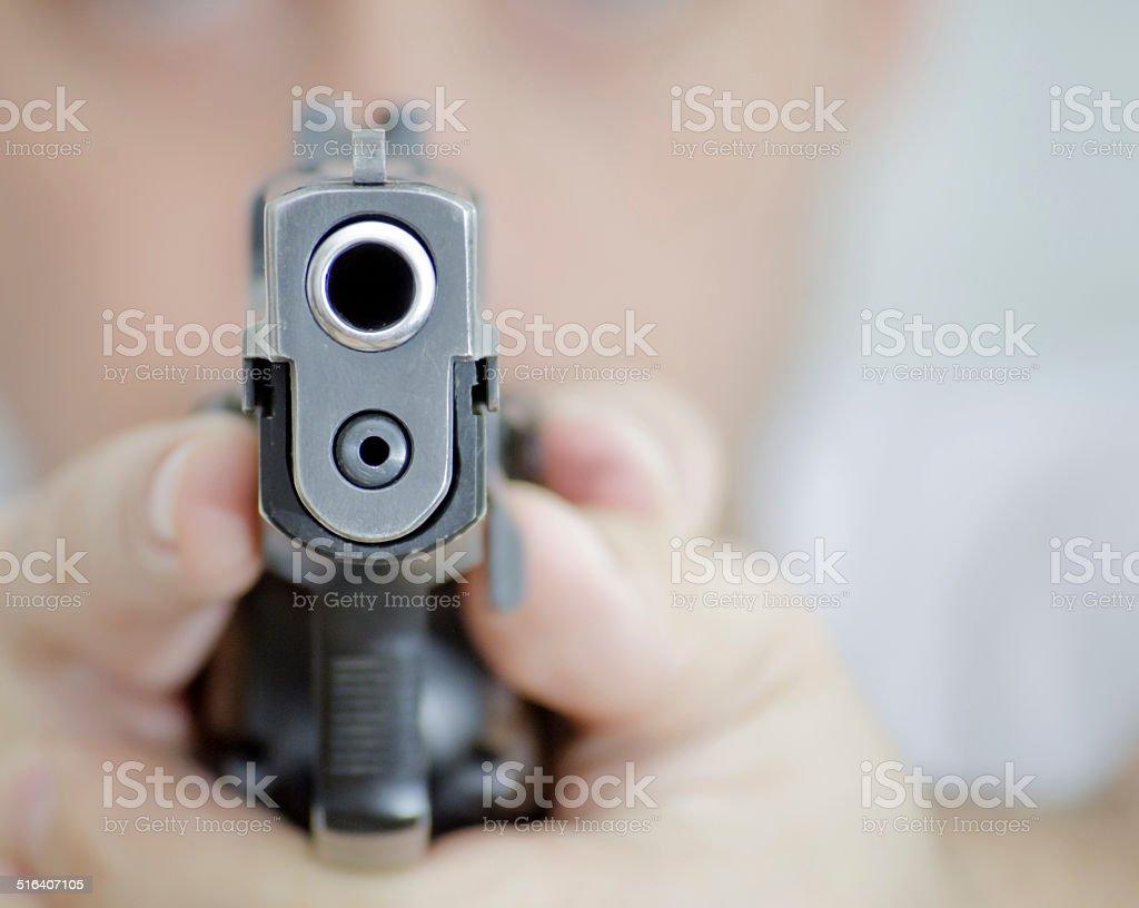 man with a gun ready to shoot stock photo