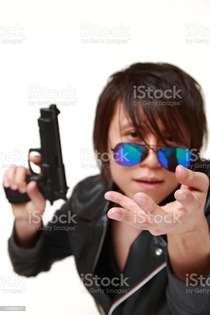 man with a handgun stock photo