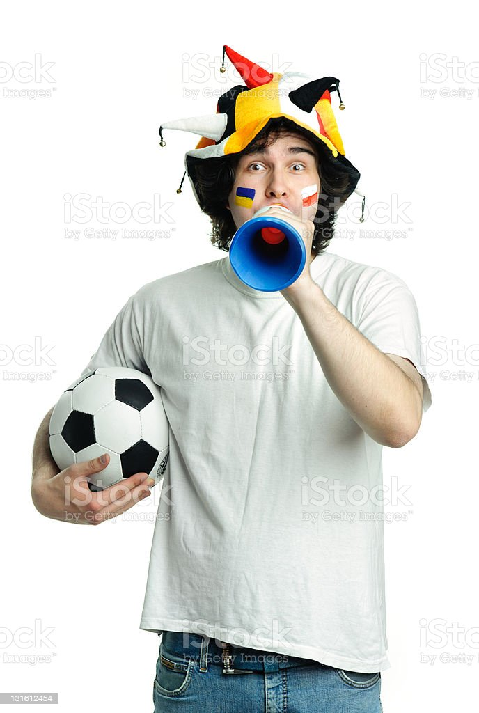 A man with a hat, soccer ball, and trumpet with face paint royalty-free stock photo
