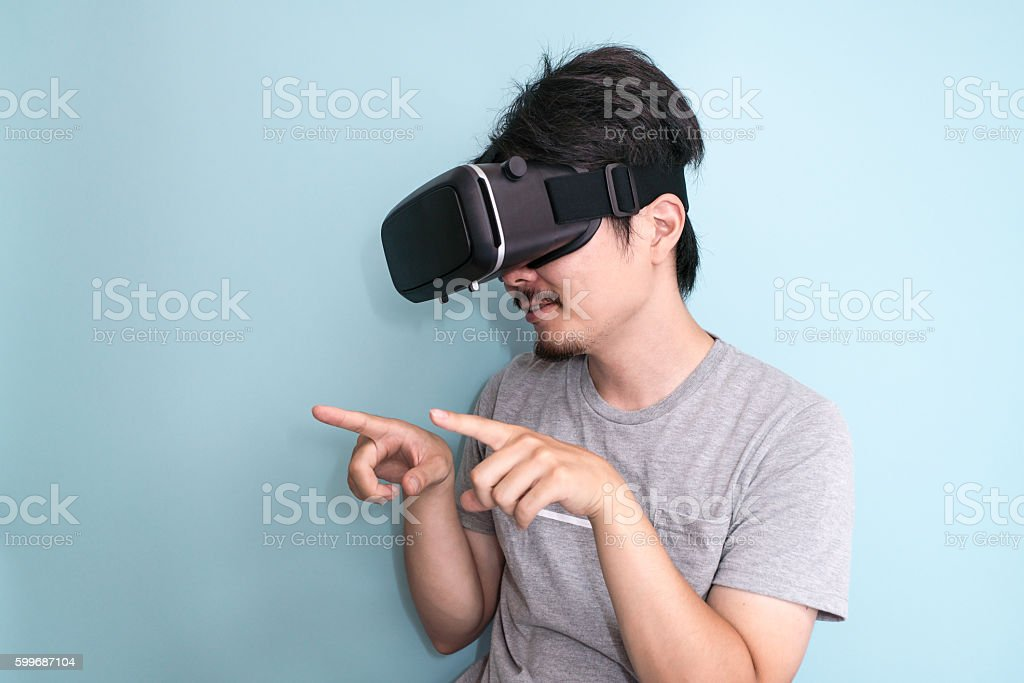 Man with a head mounted display stock photo