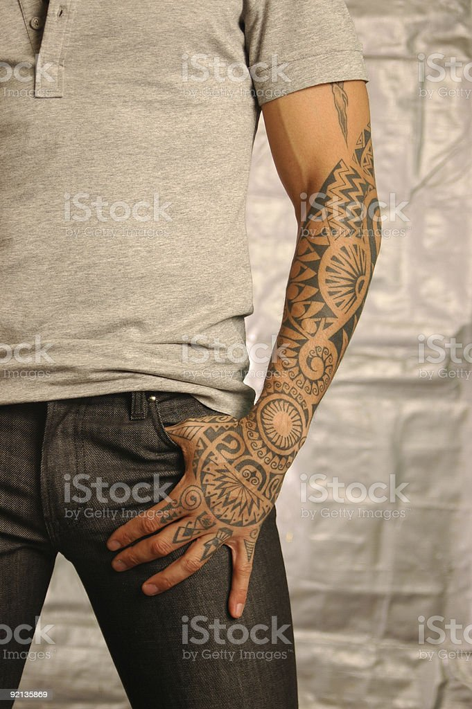 A man with a henna tattoo on his arm stock photo