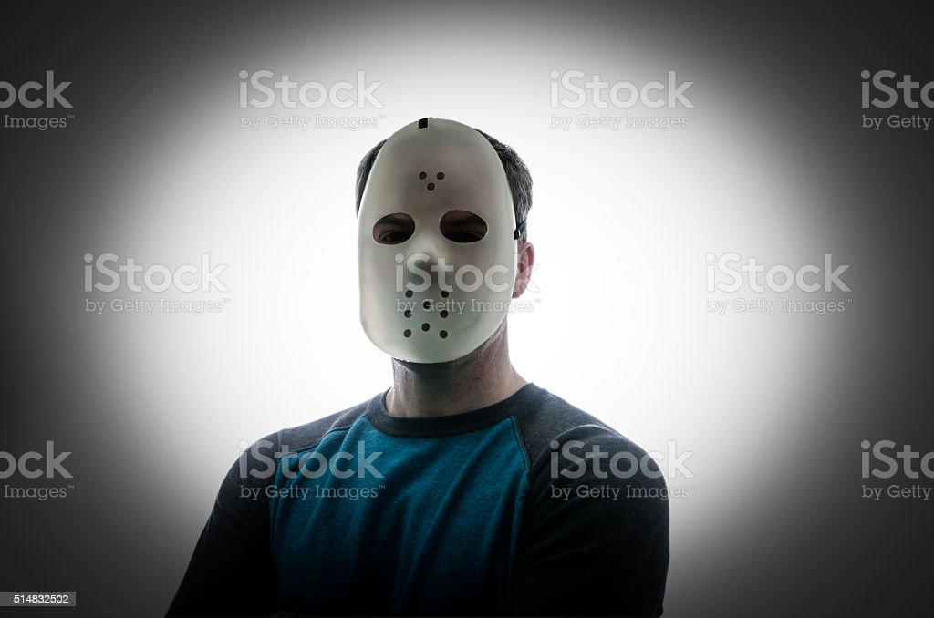 Man with a hockey mask looking like a serial killer stock photo