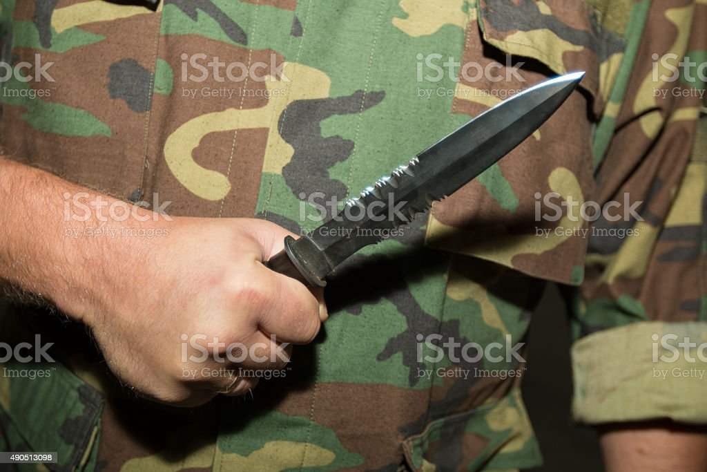 Man with a knife stock photo