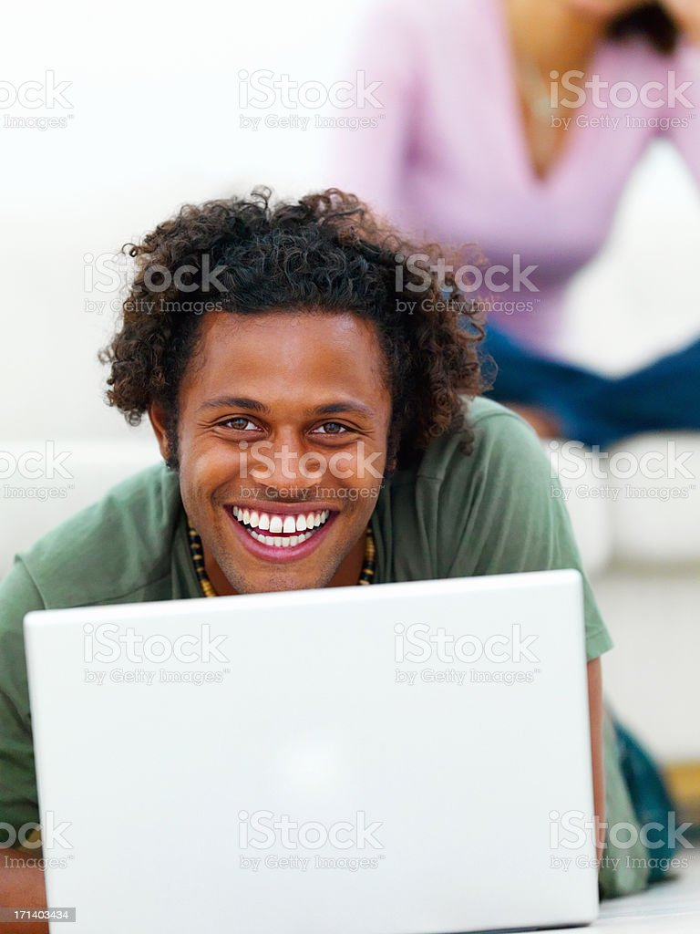 Man with a laptop and a woman in background royalty-free stock photo