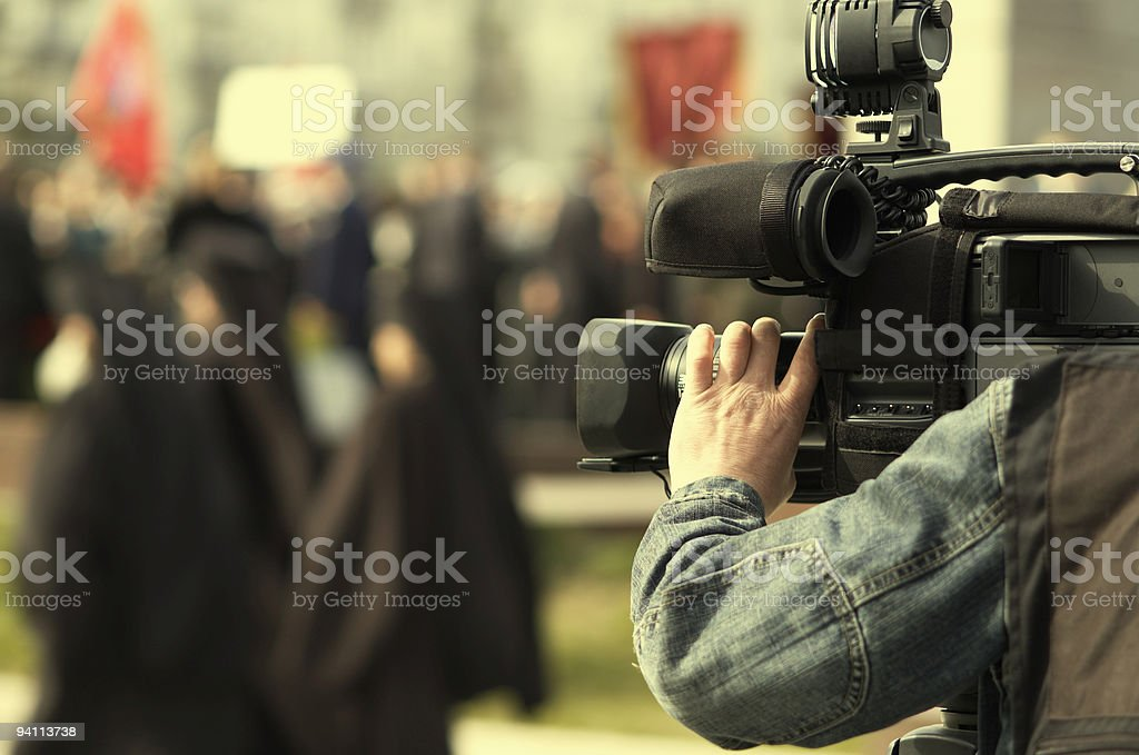 A man with a large video camera stock photo